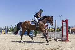Unknown rider on a horse during competition matches riding round Royalty Free Stock Images