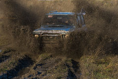 Unknown rider on the off-road vehicle overcomes a route Royalty Free Stock Images