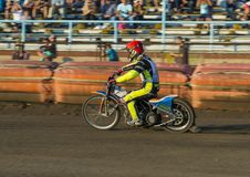 Unknown rider overcomes the track. Rivne, Ukraine - 29 August 2015: Unknown rider overcomes the track at the Open Cup Speedway to the day of the city Rivne Stock Images