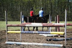 Unknown riders on a horse jumping training summertime outdoor Royalty Free Stock Photos