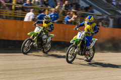 Unknown riders overcomes the track. Lviv, Ukraine - 17 April 2016: Unknown riders overcomes the track at the  Flat Track  National Championship series to the Stock Photography
