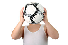 Unknown small boy holding soccer ball isolated Royalty Free Stock Photos