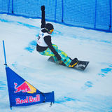 Unknown snowboarder performs during the European Cup Snowboardcross Royalty Free Stock Image