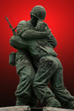 Unknown Soldier. An unknown soldier statue in the Korean Memorial in Seoul Korea with a bright red gradient background royalty free stock photo