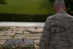 Unknown soldier in front of John F. Kennedy memorial at Arlingto Royalty Free Stock Images