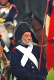Unknown soldier holding a flag at Borodino historical reenactment Stock Photos