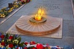 Unknown Soldier memorial Arc Triomphe Paris. Unknown Soldier memorial flame under Arc de Triomphe in Paris France since 1921 Stock Photos