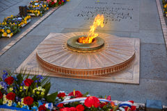 Unknown Soldier memorial Arc Triomphe Paris. Unknown Soldier memorial flame under Arc de Triomphe in Paris France since 1921 Royalty Free Stock Photos