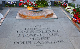 Unknown Soldier memorial Arc Triomphe Paris. Unknown Soldier memorial flame under Arc de Triomphe in Paris France since 1921 Stock Image