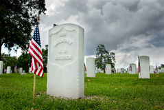 Unknown Soldiers Grave. American flag on an unknown soldiers grave at the National Cemetery in Natchez, Mississippi, placed there for Memorial Day Royalty Free Stock Image
