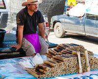 Unknown Street vendor of sticky rice in bamboo joints near famous Maeklong Railway Market Royalty Free Stock Photo