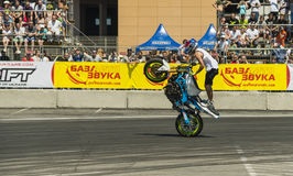 Unknown stunt biker entertain the audience. LLviv, Ukraine - June 7, 2015: Unknown stunt bikers  entertain the audience before the start of the championship of Stock Photography