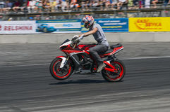 Unknown stunt biker entertain the audience Royalty Free Stock Images