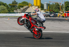Unknown stunt biker entertain the audience Royalty Free Stock Photography