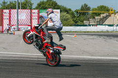 Unknown stunt biker entertain the audience Stock Photo