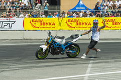 Unknown stunt biker entertain the audience. Lviv, Ukraine - June 6, 2015: Unknown stunt biker entertain the audience before the start of the championship of Stock Image