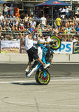 Unknown stunt biker entertain the audience. Lviv, Ukraine - June 6, 2015: Unknown stunt biker entertain the audience before the start of the championship of Stock Photography