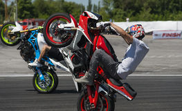 Unknown stunt bikers entertain the audience Stock Images
