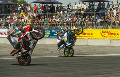 Unknown stunt bikers entertain the audience Stock Image