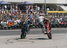 Unknown stunt bikers entertain the audience Royalty Free Stock Photo