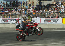 Unknown stunt bikers entertain the audience Royalty Free Stock Photography