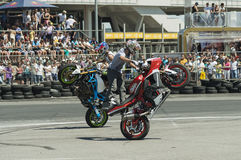 Unknown stunt bikers entertain the audience Royalty Free Stock Image