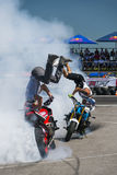 Unknown stunt bikers entertain the audience Stock Photos