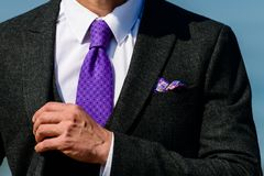 Unknown stylish groom with nice handkerchief in a jacket pocket,. Outdoors. Groom wedding detail stock images