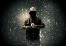 Unknown suspect standing in the dark Stock Images