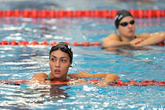 Unknown swimmer competing Royalty Free Stock Images