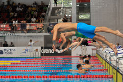 Unknown swimmer competing. BUCHAREST, ROMANIA - JULY 10: Unknown swimmer competing in Dinamo pool in Romanian International Championship Swimming , Indoor Event Stock Image