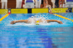 Unknown swimmer competing Royalty Free Stock Photography