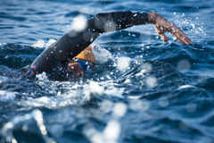 Unknown Swimmer. Unknown profesional swimmer at sea Royalty Free Stock Photography