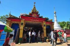 Unknown tourists visit Kyaik Pun Pagoda. Royalty Free Stock Photography