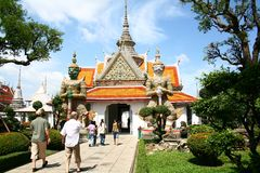 Wat Arun. An unknown tourists are walking to the entrance of Wat Arun or Temple of Dawn, A Buddhist temple (Wat) in the Bangkok Yai district of Bangkok, Thailand Stock Photo