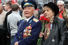 The unknown veteran on the Victory Day in Moscow during march of communists Stock Photo