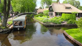 Unknown visitors in the boating in a canal in Giethoorn stock video