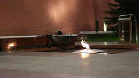 Unknown Warrior memorial in Moscow(night), Russia. Eternal flame at the Tomb of the Unknown Soldier in the Alexander Garden to honor the dead of the Great stock footage