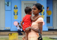 An unknown woman with a child from the island of Ceylon. Royalty Free Stock Images