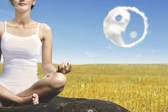 Unknown woman doing a meditation royalty free stock images