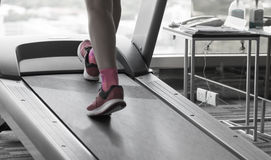 Unknown woman running in gym Stock Photos