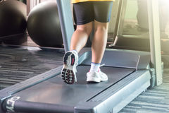 Unknown woman running with treadmill with motion Stock Photo