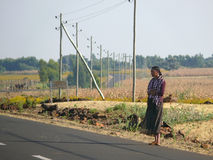 An unknown woman standing on the road in Hamusit, Ethiopia. Stock Photos