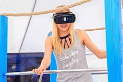 ZELENOGRADSK, KALININGRAD REGION, RUSSIA - JULY 29, 2017: Unknown young woman in virtual reality glasses in the gaming pavilion.. Unknown young woman in virtual Stock Image