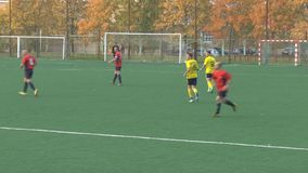 Unknowns athletes are playing football. Unknowns athletes in red and yellow uniform are playing football stock video