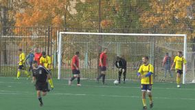 Unknowns athletes are playing football. Unknowns athletes in red and yellow uniform are playing football stock video footage