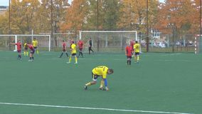 Unknowns athletes are playing football. Unknowns athletes in red and yellow uniform are playing football stock footage