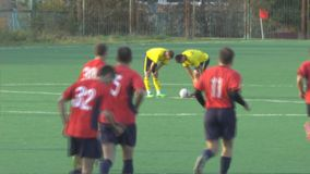Unknowns athletes are playing football stock video footage