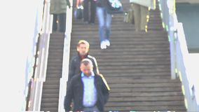 Unknowns people go down the stairs. Not in focus stock video footage