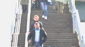 Unknowns people go down the stairs. Not in focus stock footage